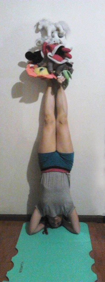 Asking my sister to be upside down so I can put stuffed animals on her feet.