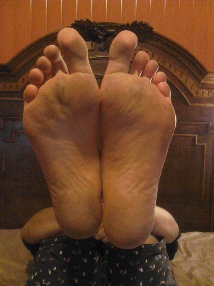 Taking a picture of the bottom of my feet