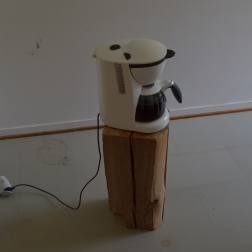 Coffee maker on log