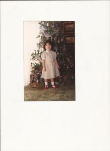 Posting a picture of me as a kid next to the christmas tree